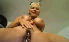 Busty Slut Shows Off Her Pierced Pussy