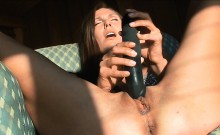 Naughty gal pushes glass dildo in moist pussy and ass