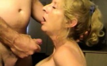 Mature blonde gets down on her knees to suck on her lover's