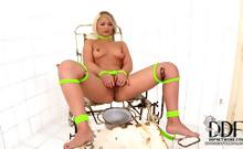 Sexy blonde pisses in bowl