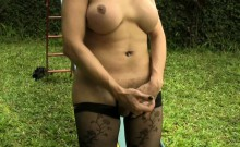 Shemale in stockings wanks off and jizzes over her big boobs
