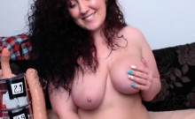 Busty milf with curly hair masturbating on webcam