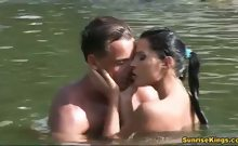 Lucy Belle gives a blowjob in the river