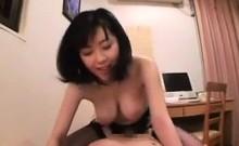 Busty Japanese Girl Wearing Stockings