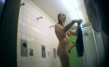 Two hot girls get naked and take a shower on a hidden camer