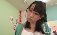 Horny asian teacher seducing a school boy in classroom