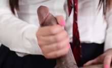 Brunette schoolgirl massages a big dick