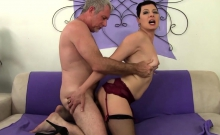 Sexy mature woman and a guy kiss each other She gives him a