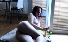 busty babe spreading legs and sucking dildo