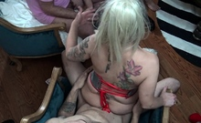 Blonde swinger MILF in sexy fishnet riding big cock