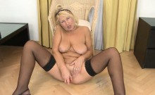 Old horny Mom masturbates with a big toy on the floor